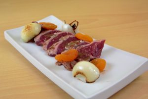 Iberian tenderoin, dried peaches, french onion & sauce